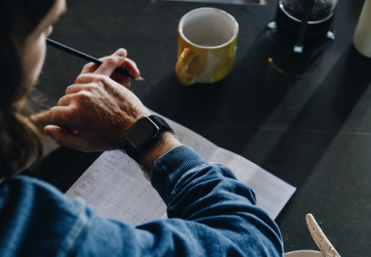 Man checking                 the sleep data on his Apple watch to add into his Kick sleep                 journal