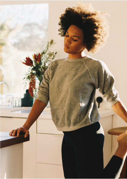 woman doing morning stretches after restful night of sleep