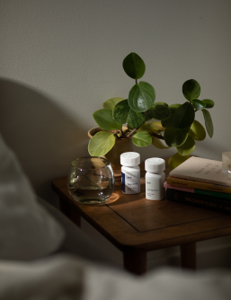 Kick               Trazodone and Gabapentin sleep prescription bottles on bedside               stand